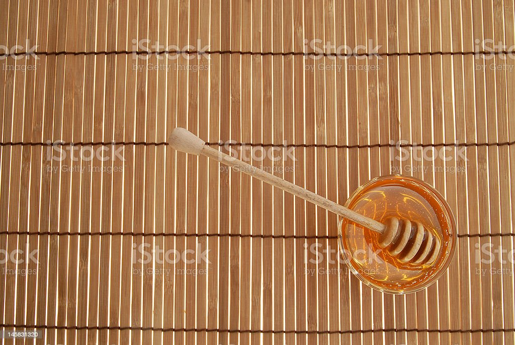 Glass honey with sticks royalty-free stock photo