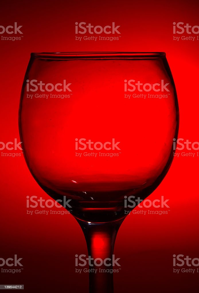 Glass in red background. royalty-free stock photo