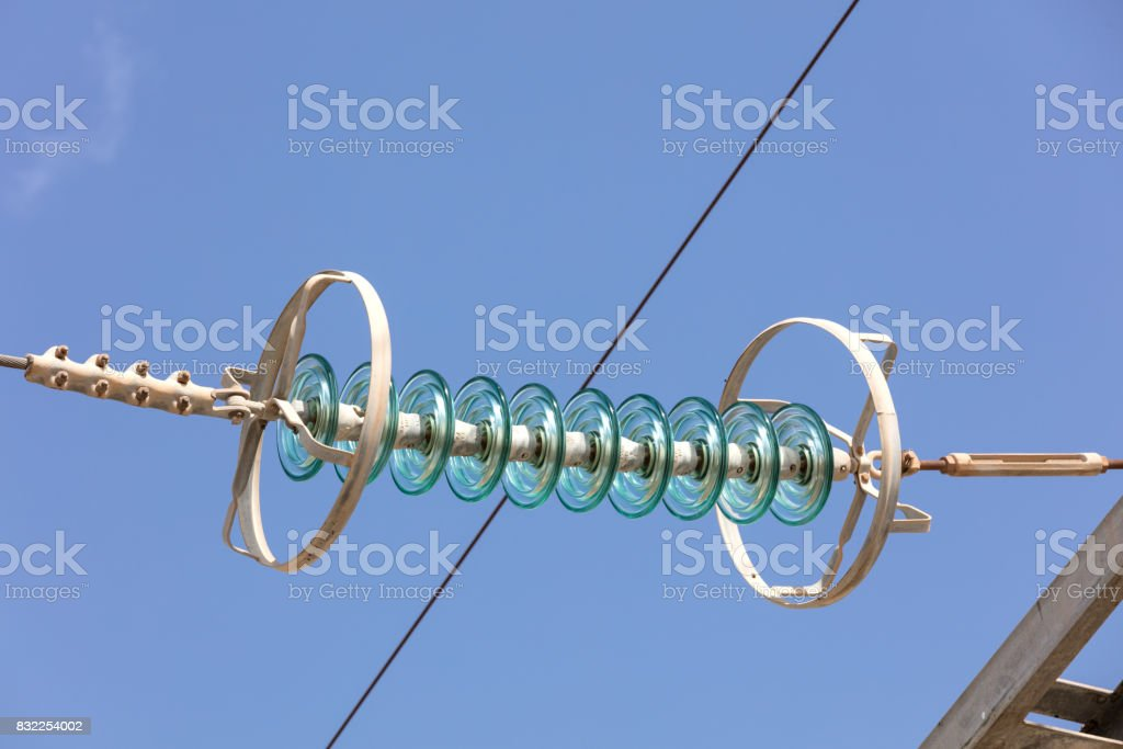 glass insulators in a high voltage wire stock photo
