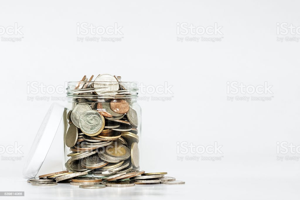 Glass jar full of coins, with copy space stock photo