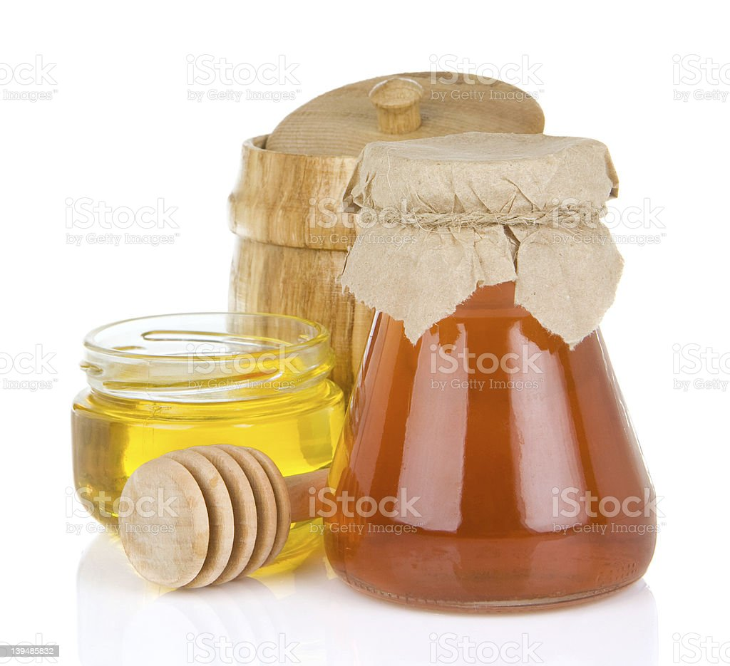 glass jar full of honey and stick royalty-free stock photo