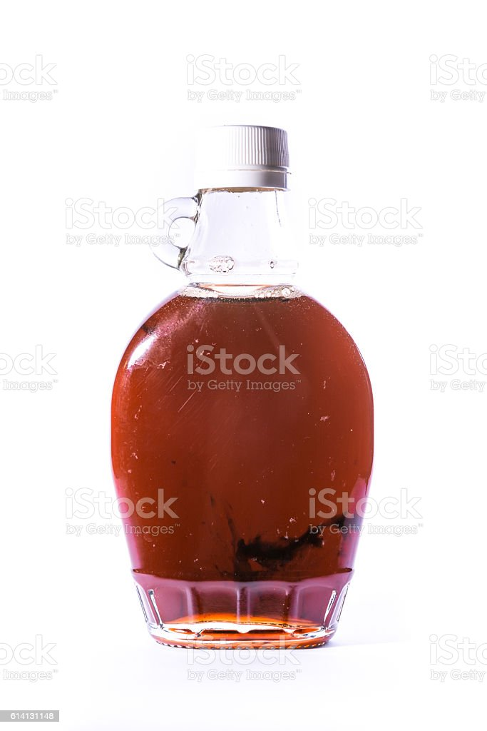 Glass Jar Jug Clear Brown Maple Syrup Container White Isolated stock photo