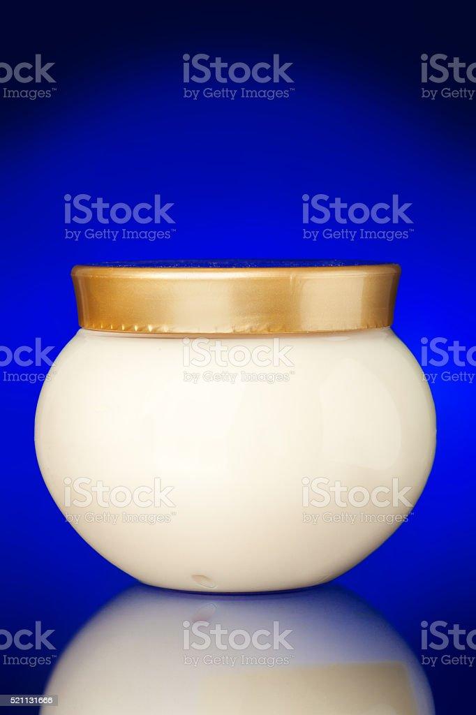 Glass jar of cream. stock photo