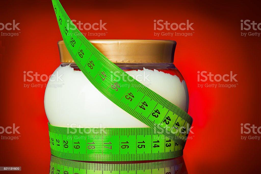 Glass jar of cream with centimeter. stock photo