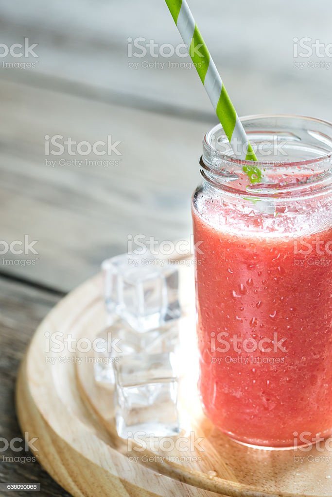 Glass jar of grapefruit smoothie stock photo