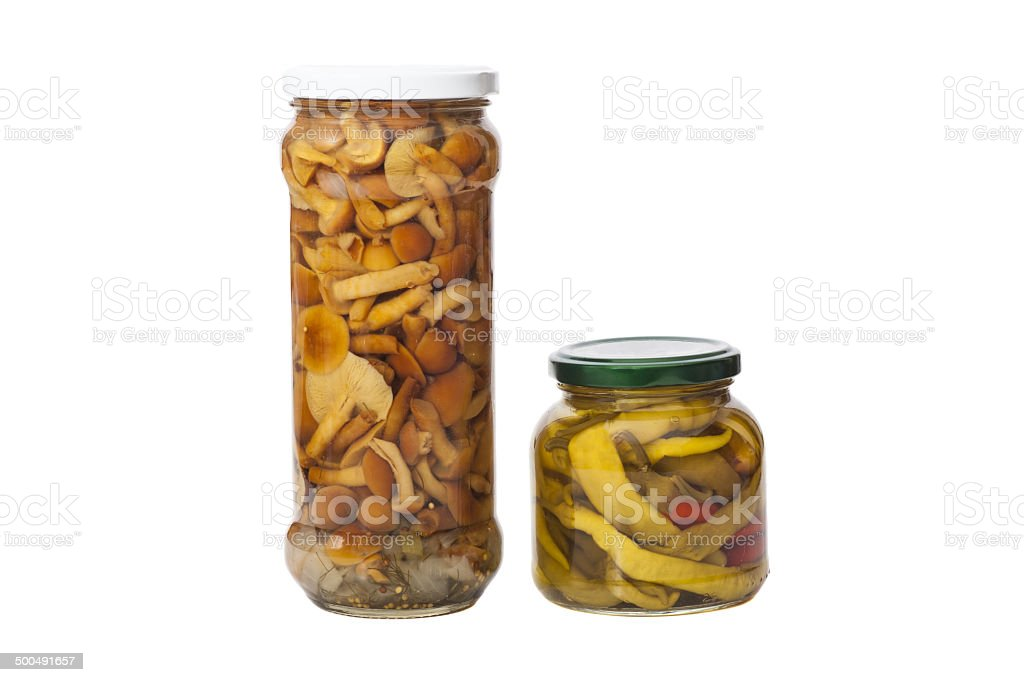 Glass jar of preserved mushrooms and canned peppers stock photo