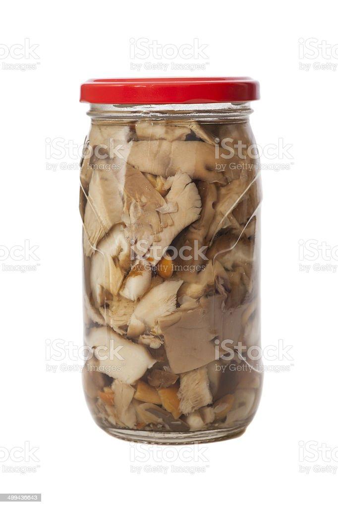 Glass jar of preserved mushrooms stock photo