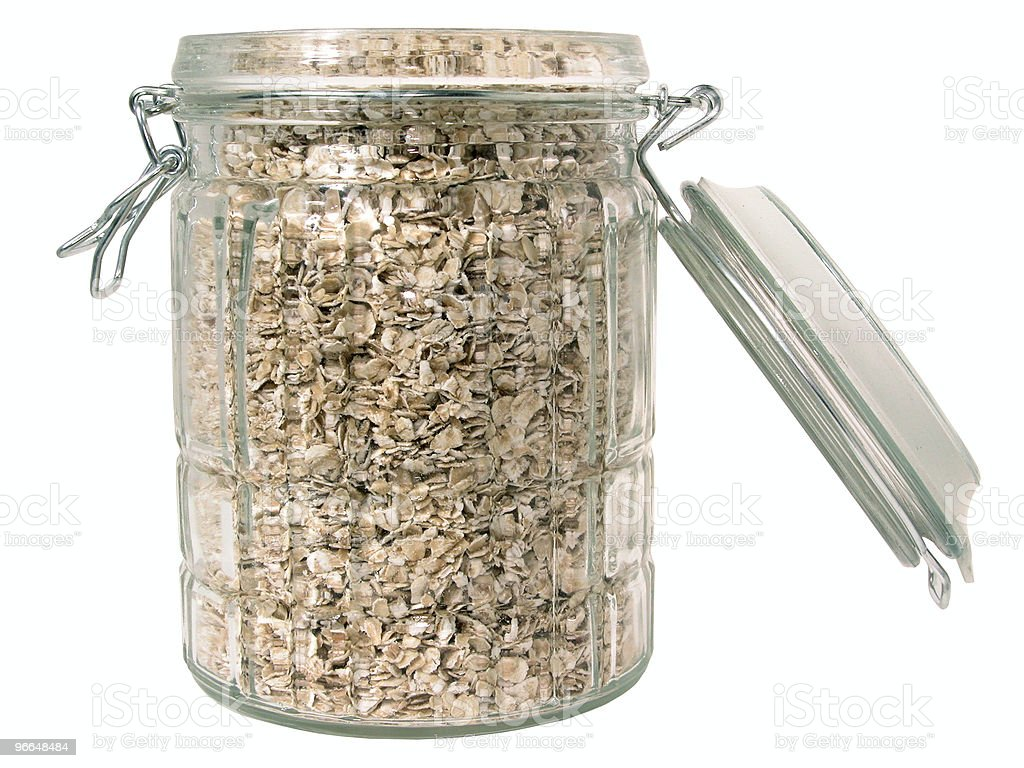 Glass Jar of Raw Oats (Isolated) royalty-free stock photo