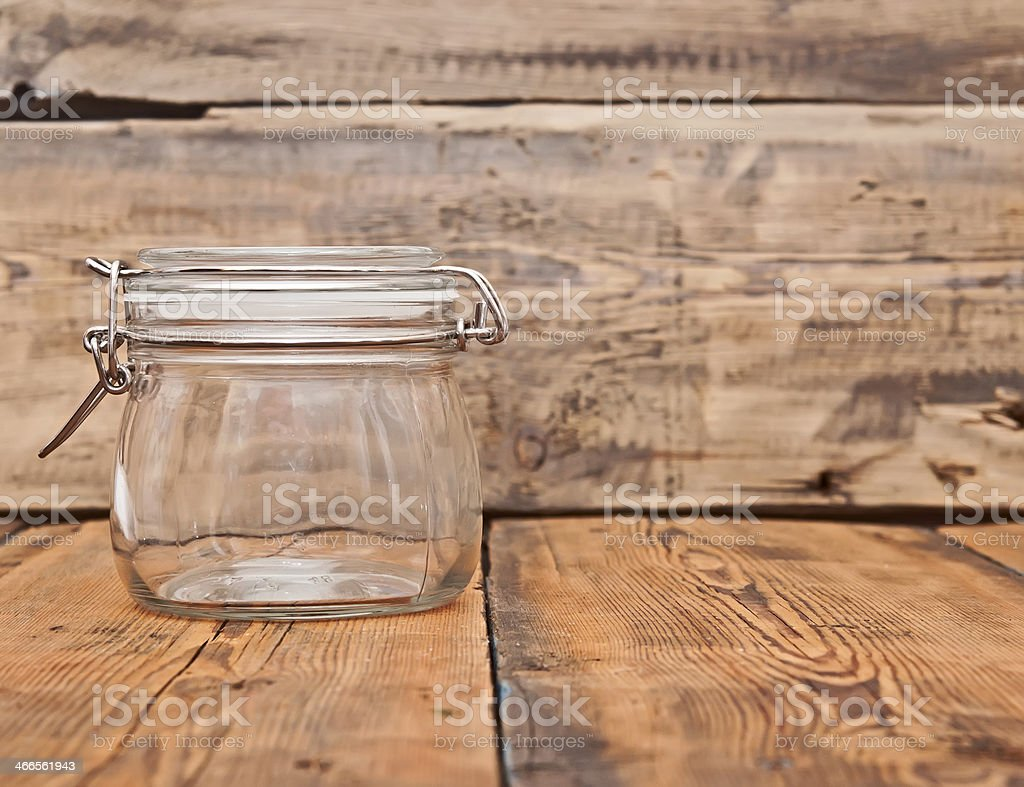 glass jar on old wooden table stock photo