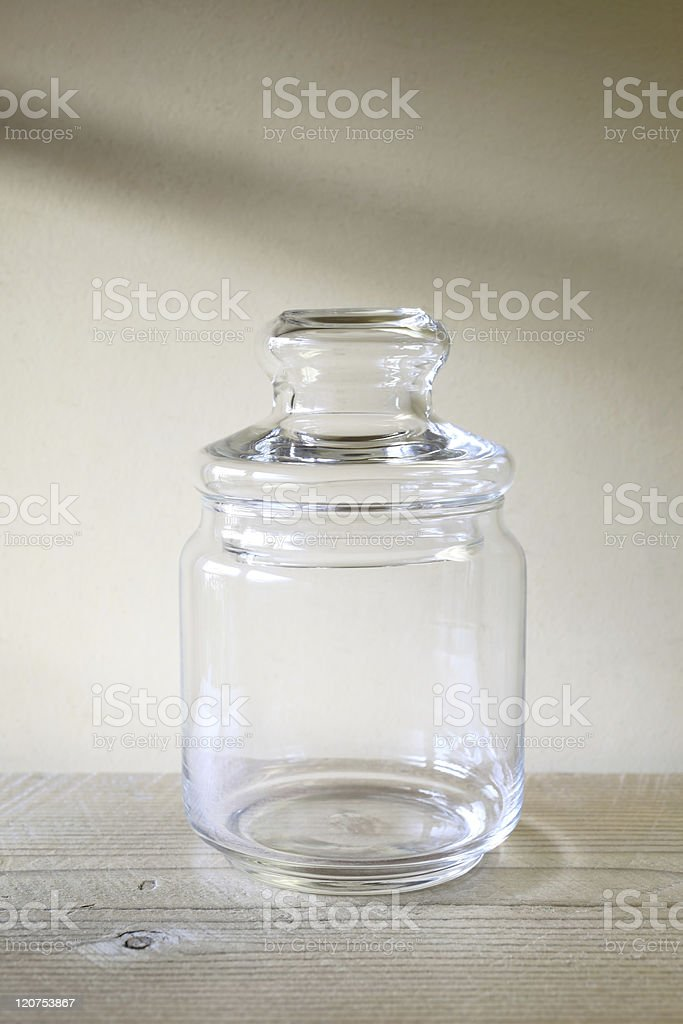 Glass jar on wooden table royalty-free stock photo