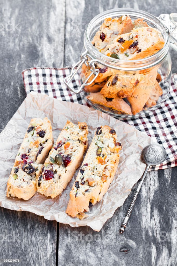 Glass  jar with biscotti on wooden vintage table stock photo
