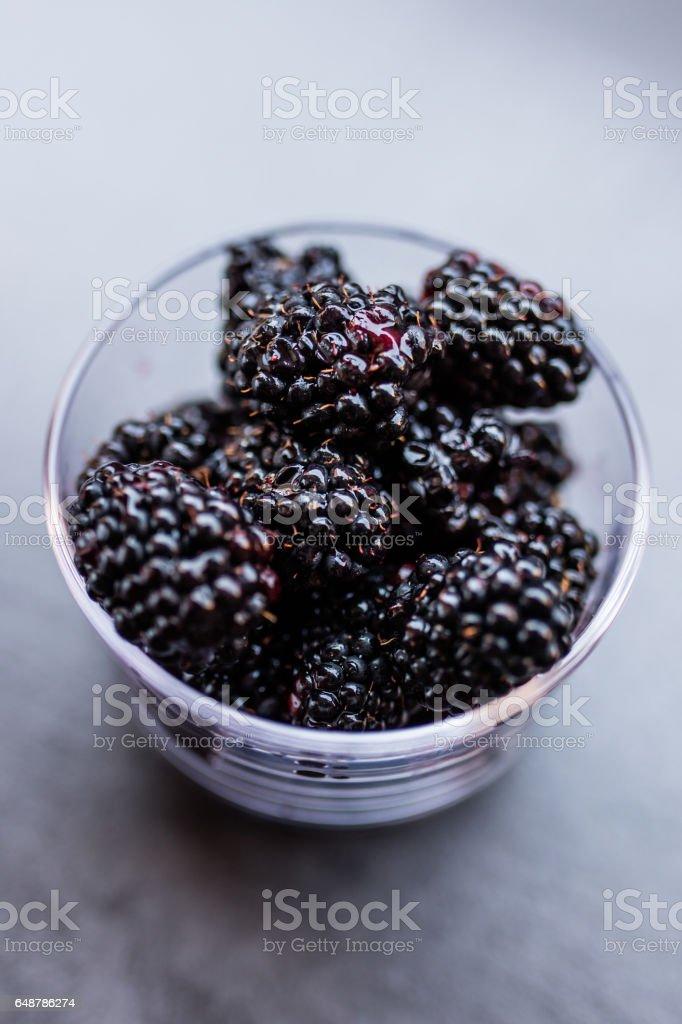 Glass jar with blackberries stock photo