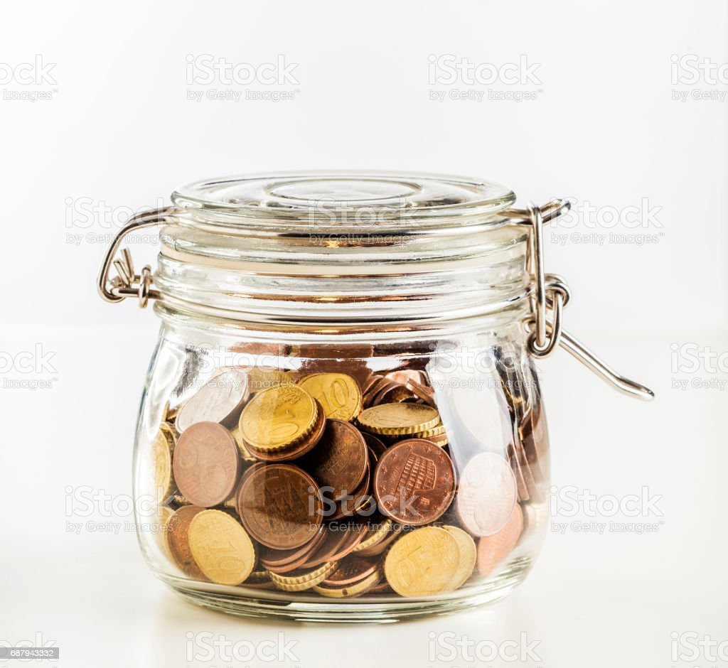 glass jar with coins stock photo