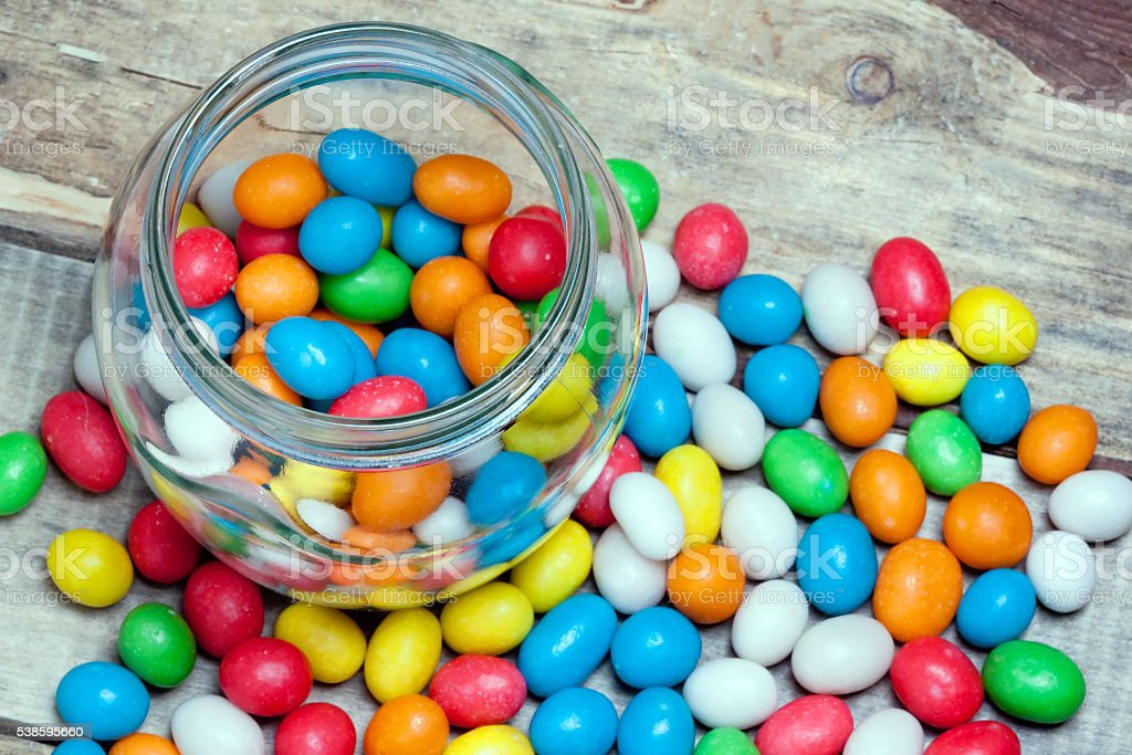 glass jar with colorful candy stock photo