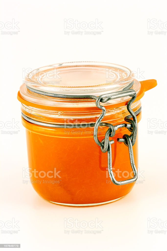 Glass jar with homemade apricot royalty-free stock photo