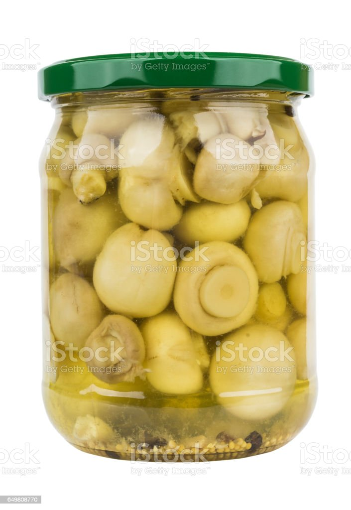 Glass jar with marinated champignons isolated on white stock photo