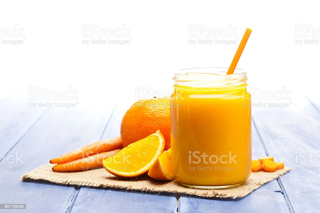 Glass jar with orange and carrot juice stock photo