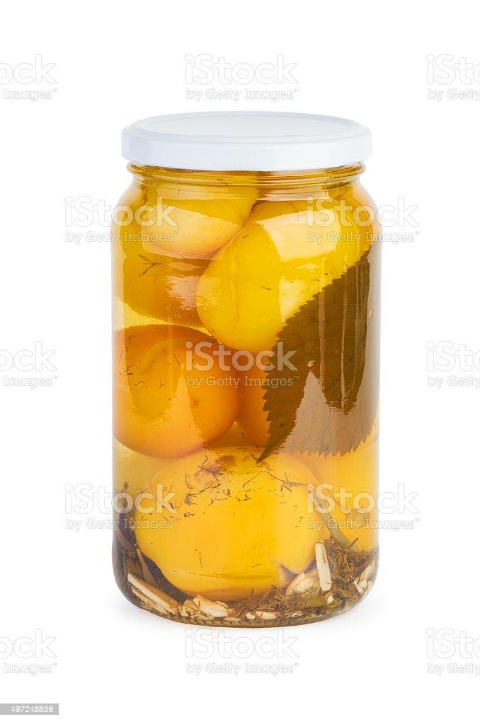 Jarra de vidro com picado Tomate Amarelo foto de stock royalty-free