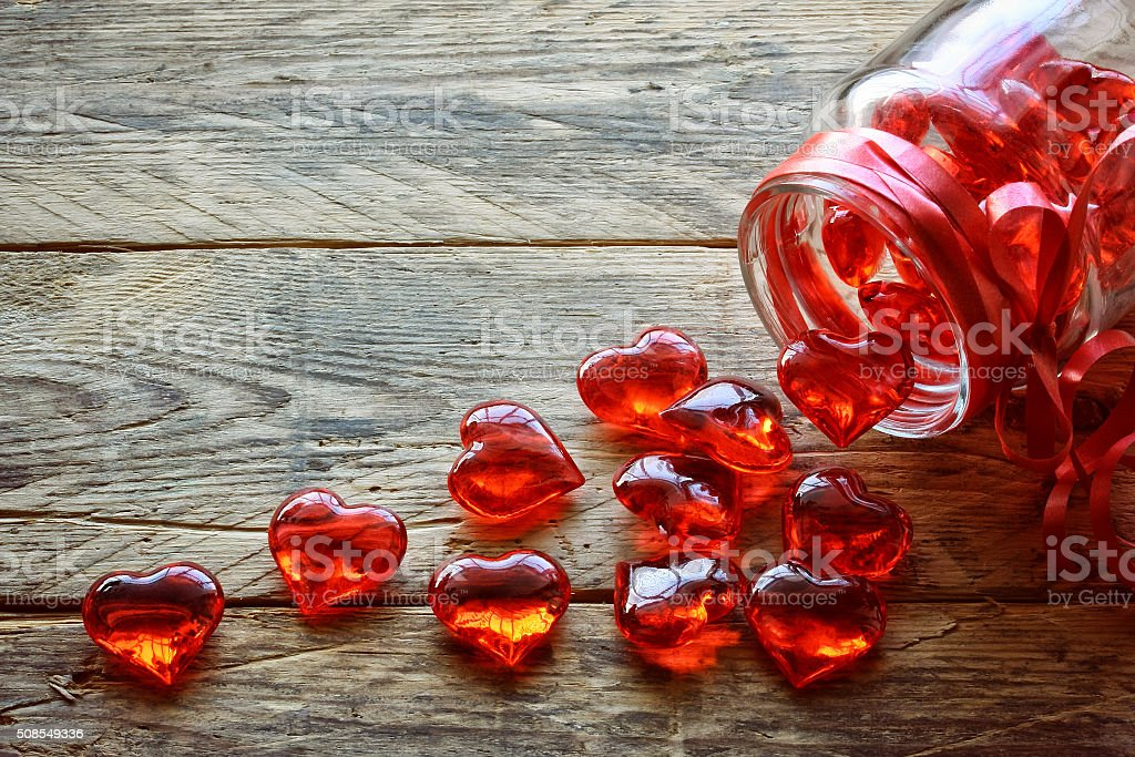 glass jar with red translucent heart stock photo
