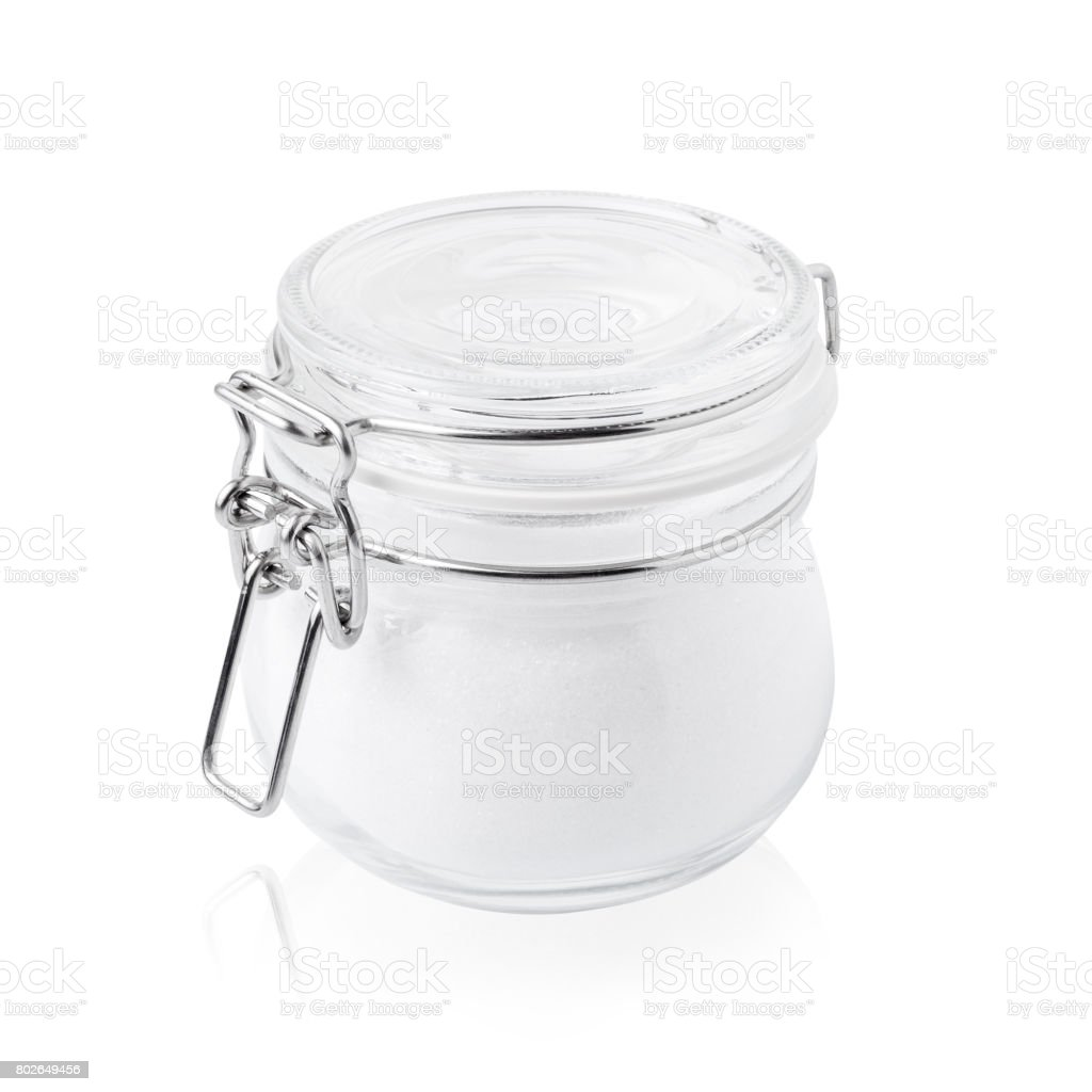 glass jar with sugar, closed, isolated on white stock photo