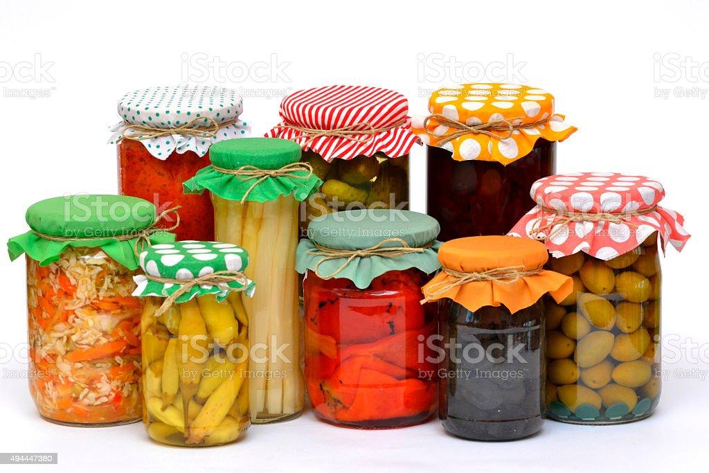 Glass jars full of preserved vegetables stock photo