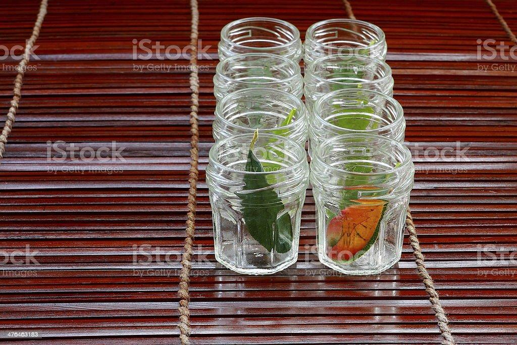 Glass jars in row stock photo
