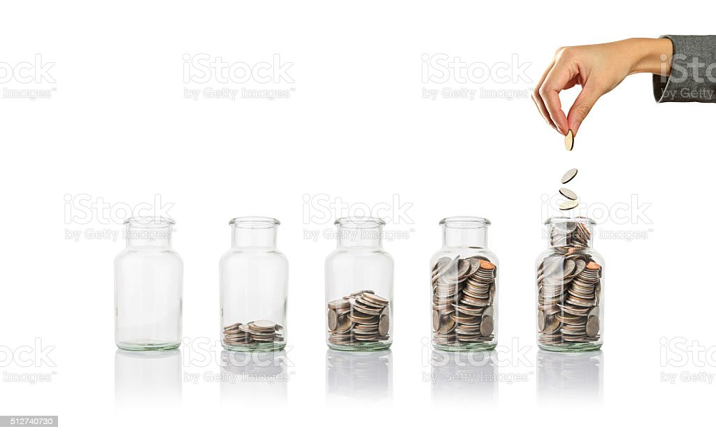 Glass jars with coins, savings concept stock photo