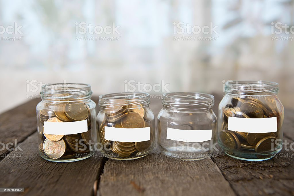Glass jars with money coins ruble and empty sticker stock photo