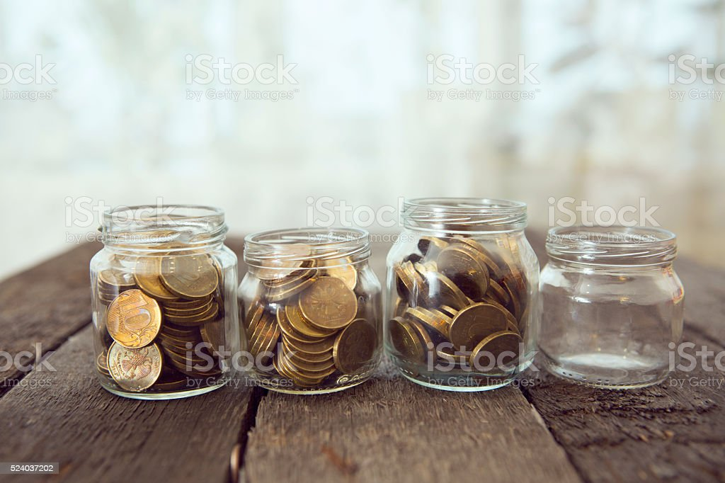 Glass jars with money coins ruble stock photo