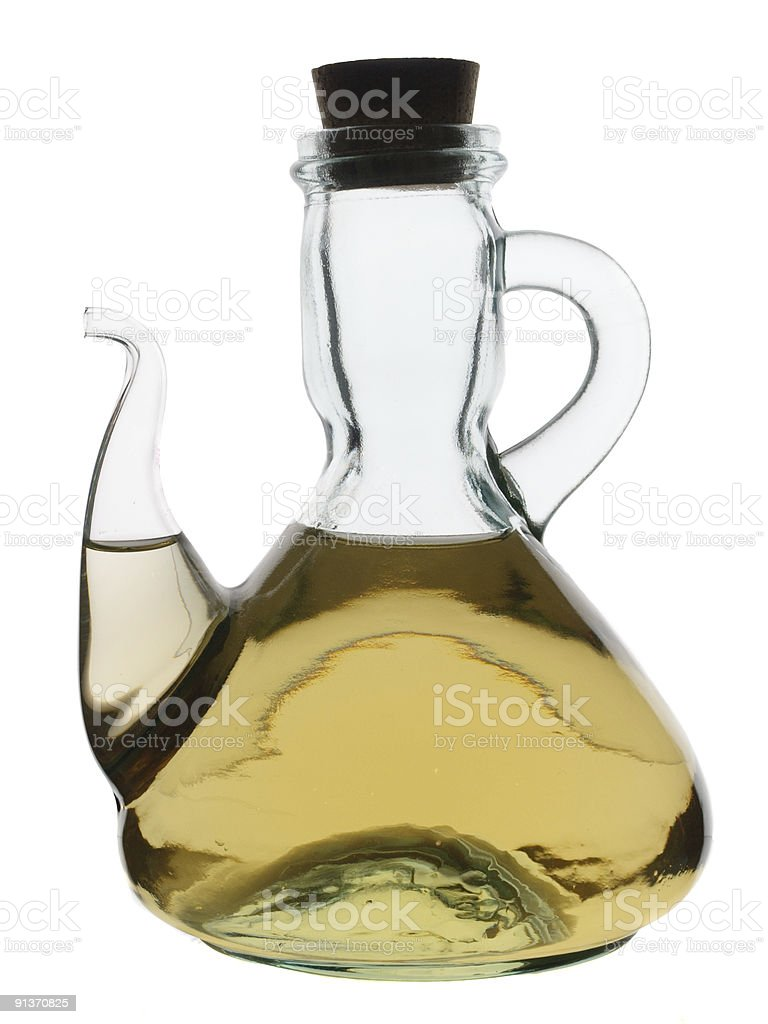 Glass jug filled with vinegar royalty-free stock photo