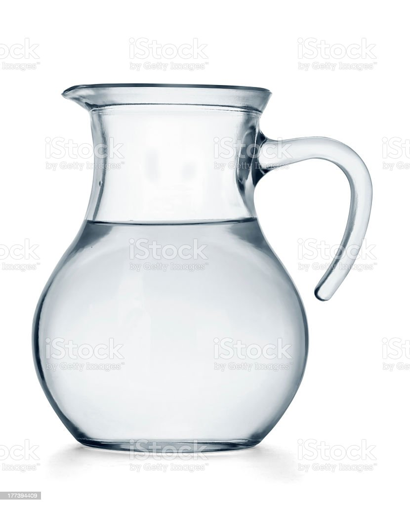 Glass jug full of water against a white backdrop stock photo