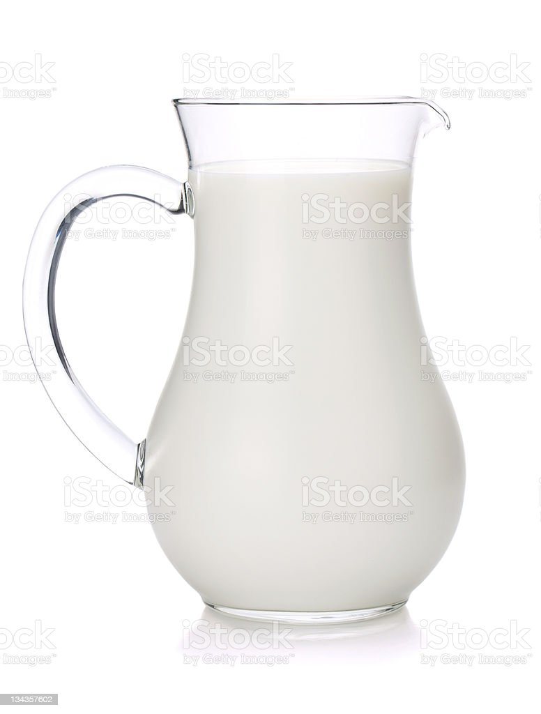 Glass jug of milk on white background stock photo