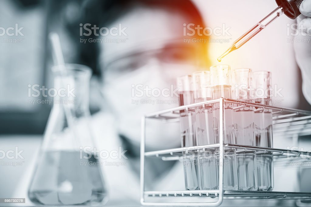 Glass laboratory chemical test tubes with liquid. stock photo