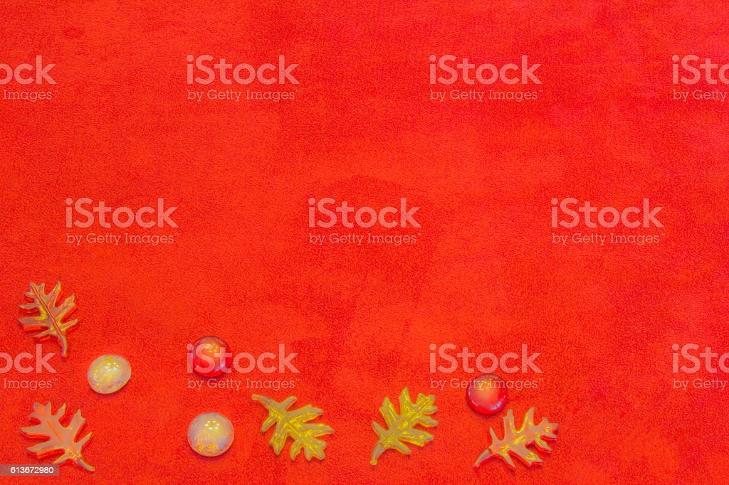 Glass leaves , pebbles in fall color on suede cloth (P) stock photo