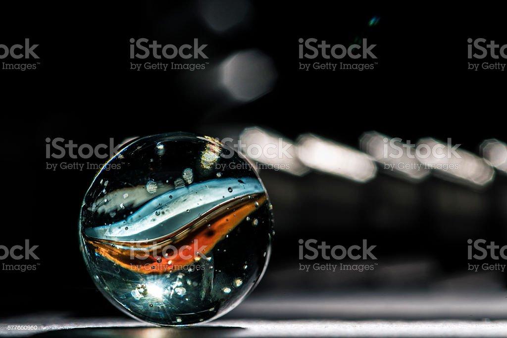 Glass marble macro close up stock photo