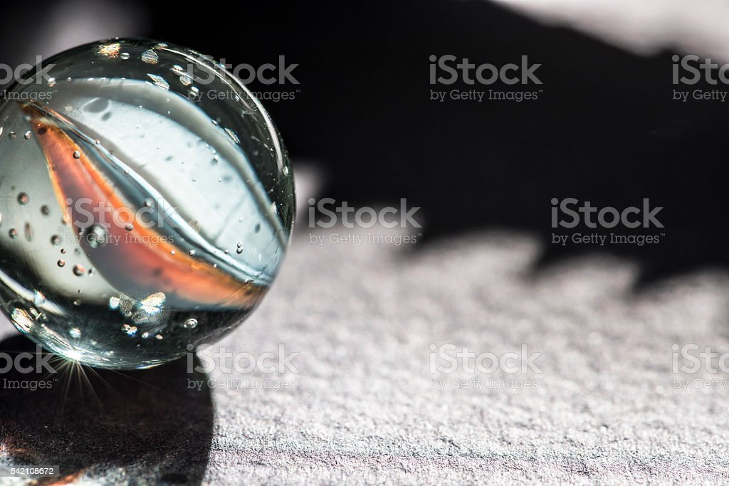 Glass marble macro stock photo