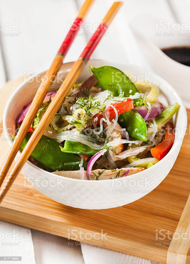 Glass noodles with vegetables and chicken stock photo