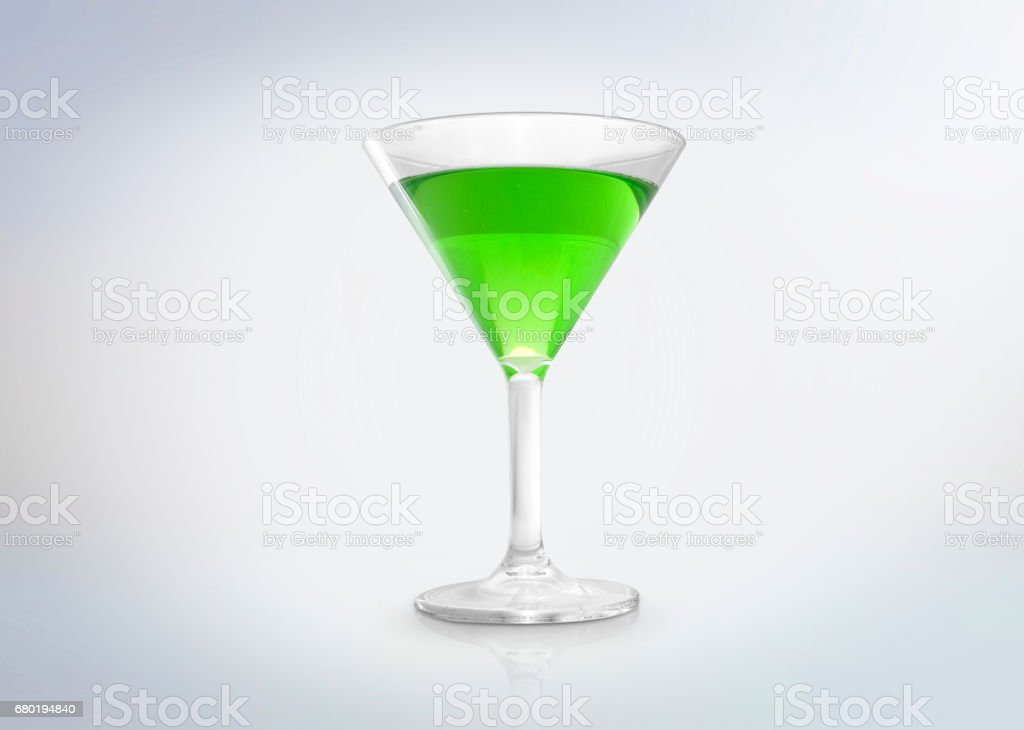 Glass of a green cocktail drink. stock photo