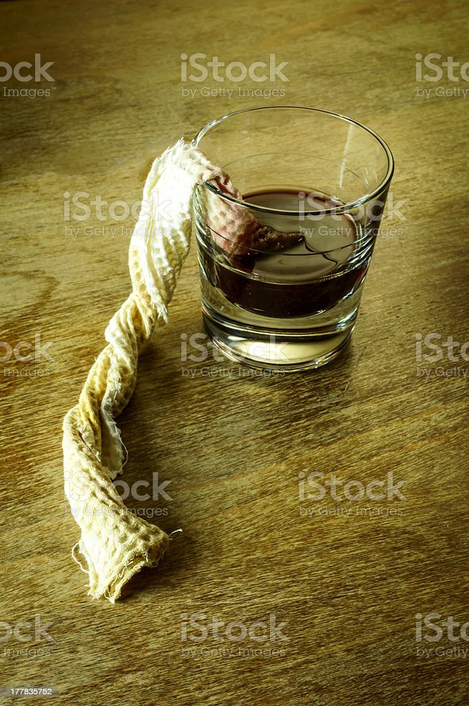 glass of alcohol and a cloth royalty-free stock photo
