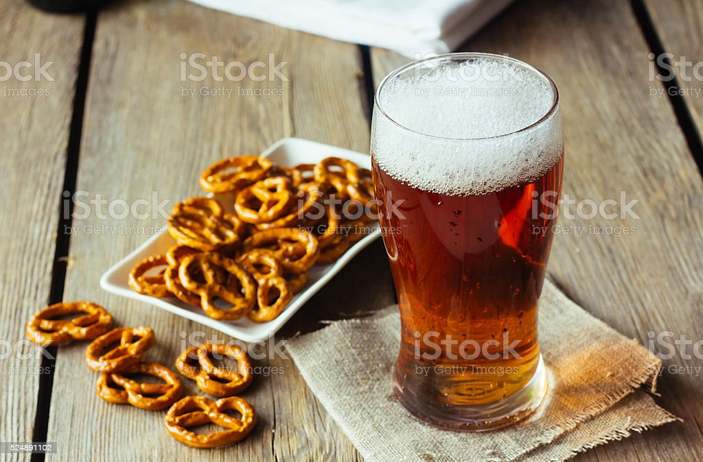 Glass of ale and snacks stock photo