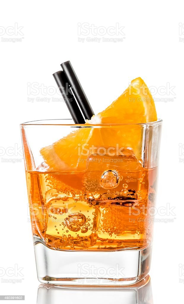 glass of  aperitif cocktail with orange slices stock photo
