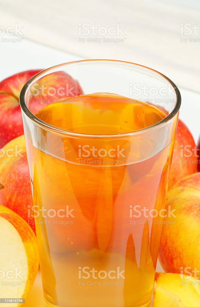 glass of apple cider and apples royalty-free stock photo