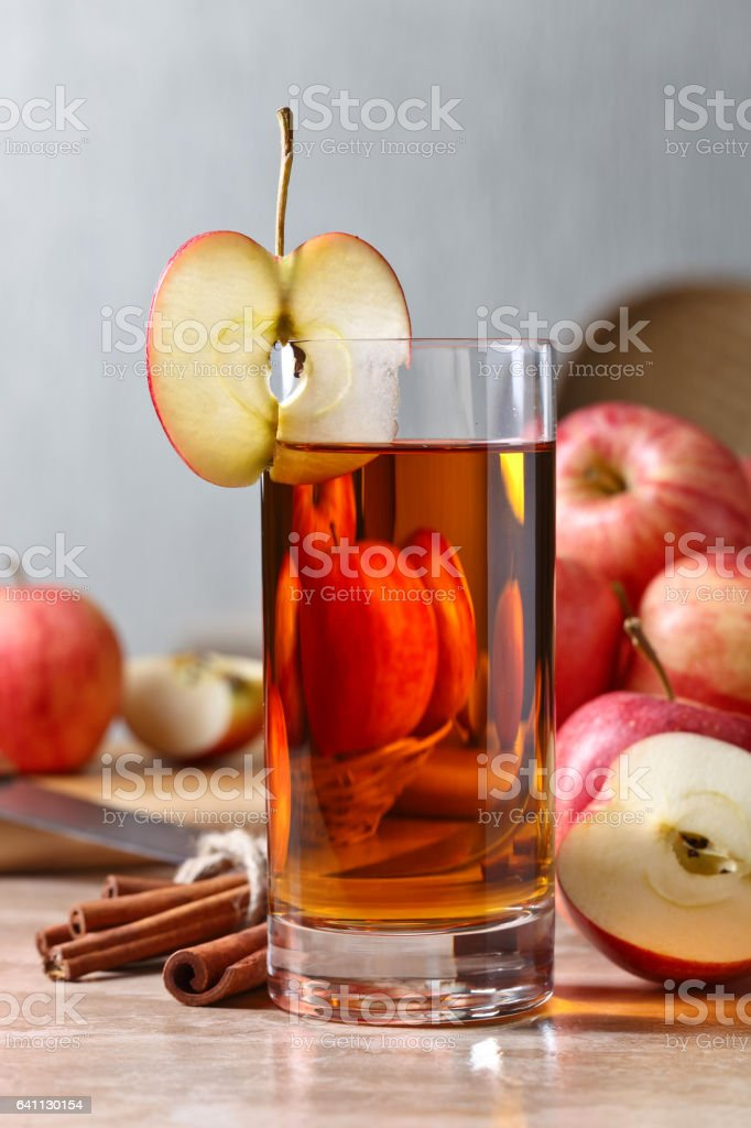 Glass of apple juice and ripe pink apples stock photo