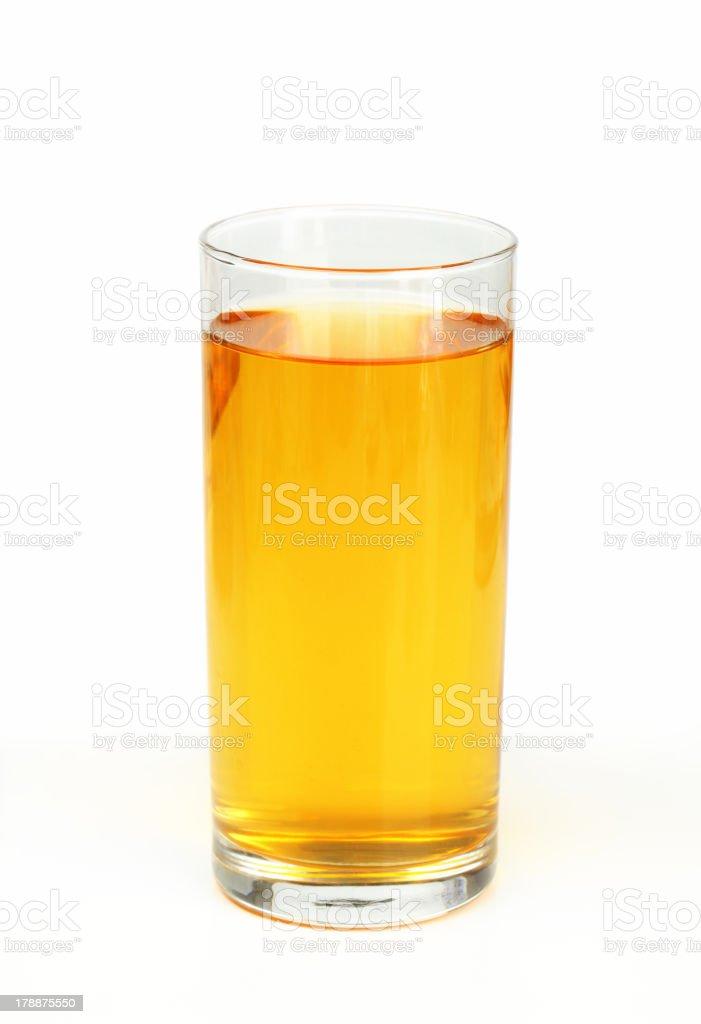 Glass of apple juice on white background stock photo