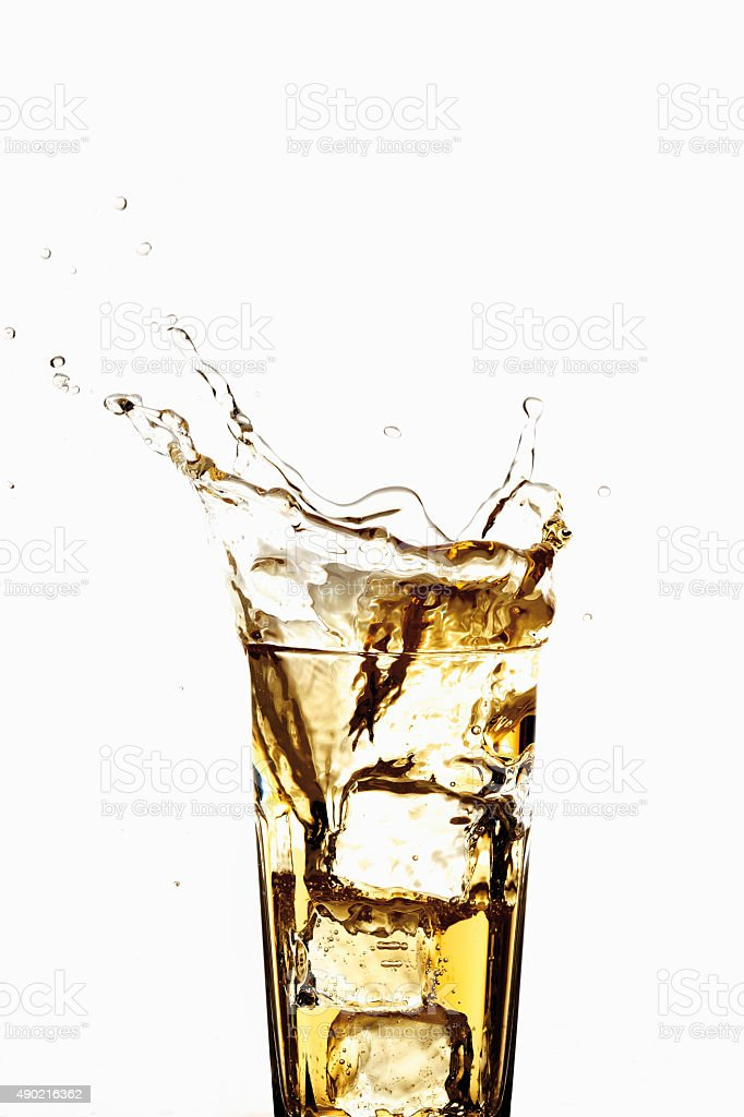 Glass of apple spritzer with ice cubes, close-up stock photo