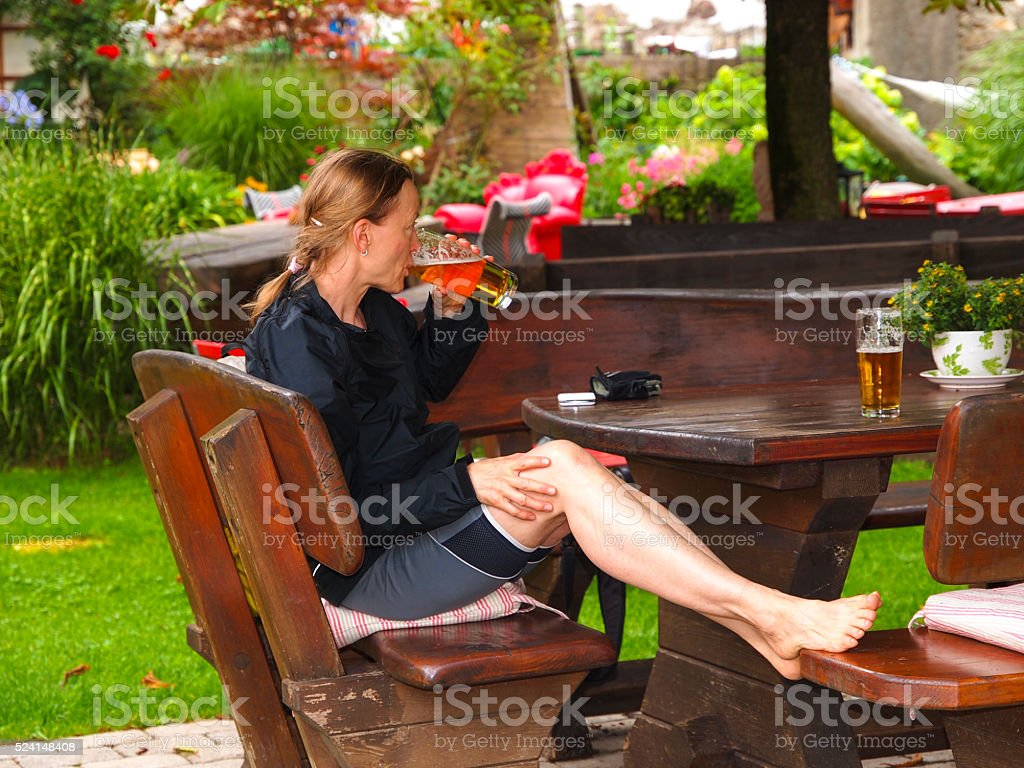 Glass of beer after long cycling on Drauradweg in Austria stock photo