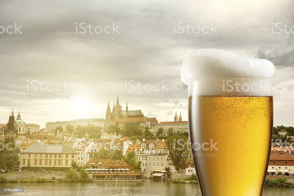 Glass of beer against view of Prague stock photo