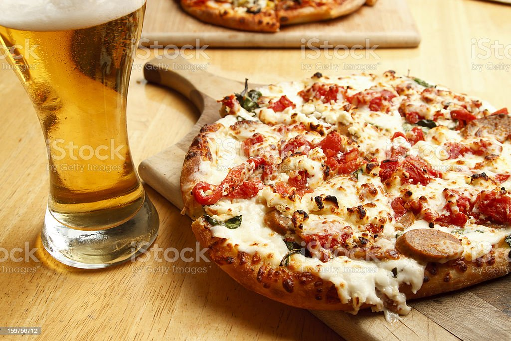 Glass of beer and a freshly baked pizza stock photo