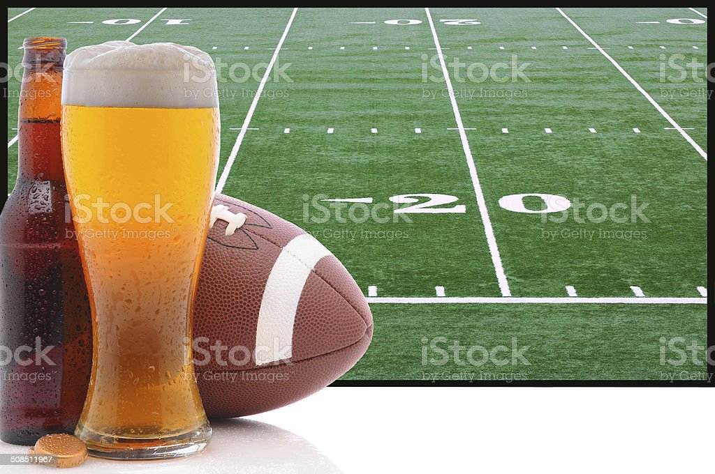Glass of Beer and American Football stock photo