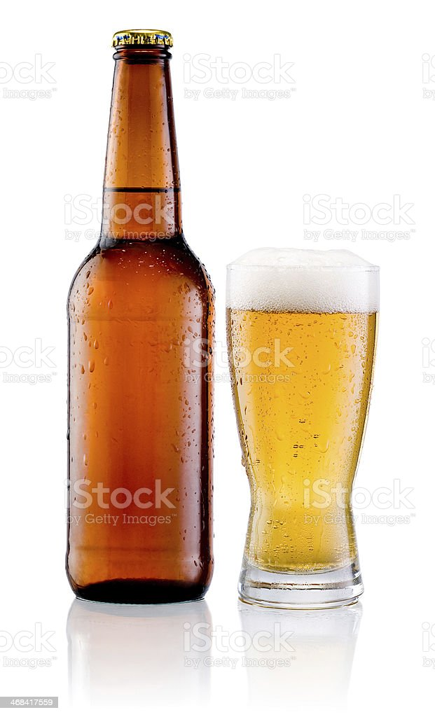 Glass of beer and Brown bottle with drops isolated royalty-free stock photo